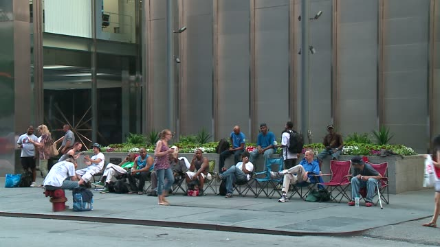 wgn people wait in line the day before hamilton tickets went on sale at the private bank theatre in chicago on june 20 2016 - broadway stock videos & royalty-free footage