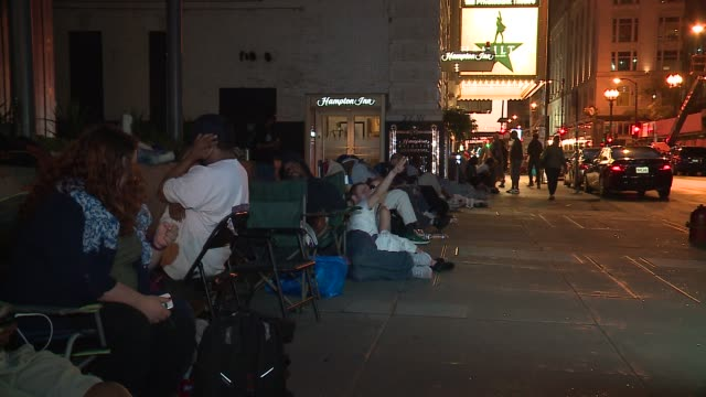 wgn people wait in line the night before hamilton tickets went on sale at the private bank theatre in chicago on june 20 2016 - broadway stock videos & royalty-free footage