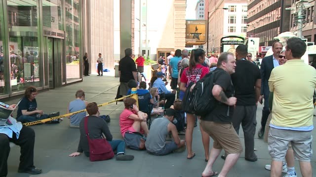 wgn people wait in long line for hamilton tickets at the private bank theatre in chicago on june 21 2016 - broadway stock videos & royalty-free footage