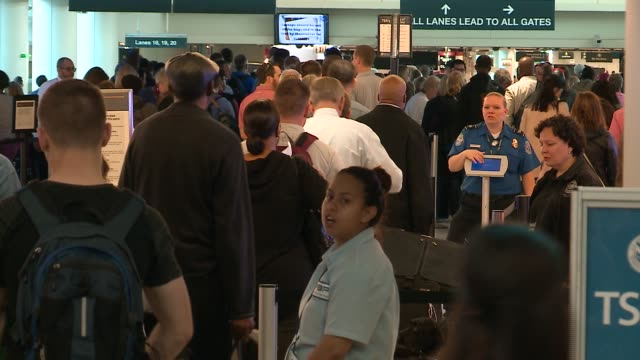 WGN People Wait in Long Lines at Chicago's Midway Airport on May 13 2016