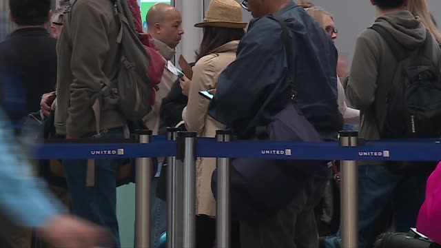 WGN People Wait in Long Security Check Lines at O'Hare Airport in Chicago on May 10 2016