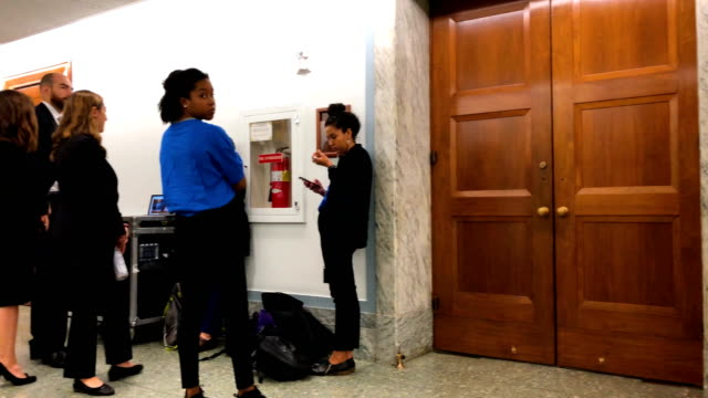 people wait inline to enter the room to listen to a hearing before the senate judiciary committee october 10 2018 at dirksen senate office building... - senate stock videos & royalty-free footage