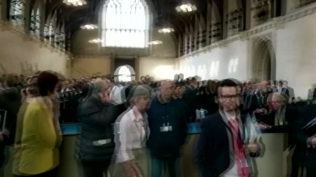 People wait inside the parliament building after at least one man was shot dead by police outside Parliament Square after stabbing a police officer...