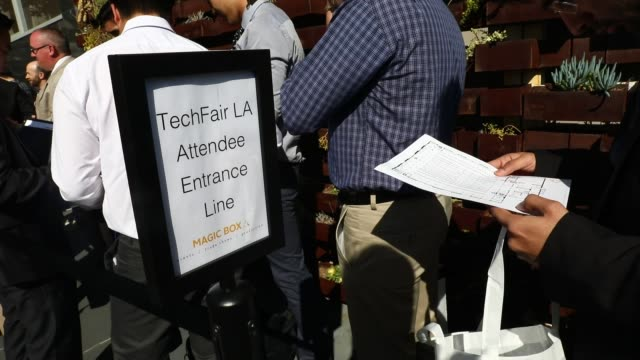 people wait outside in a line during the techfair la job fair in los angeles california us on thursday jan 26 2017 shots wide shot of huge line of... - unemployment application stock videos & royalty-free footage