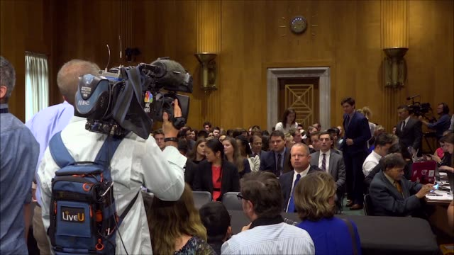 People wait outside the Senate Foreign Relations Committee hearing room for Secretary of State Mike Pompeo to enter Senators enter the room and take...