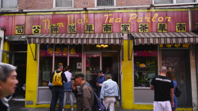 people wait to have a table for one of popular dim sum restaurant on doyers street in china town at new york city ny usa on may 22 2019.a town at new york city. - placard stock videos & royalty-free footage