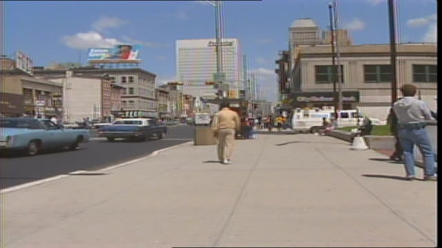 stockvideo's en b-roll-footage met people waiting at a bus stop on broad street in newark new jersey in 1986 - 1986