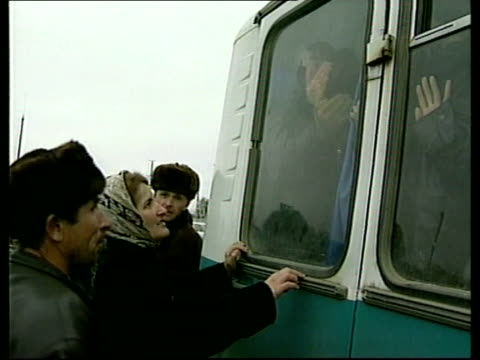 people waiting beside bus from chechnya cms refugees on bus to people waiting tgv crowds waiting beside bus tms russian soldier on steps of bus as... - grosny stock-videos und b-roll-filmmaterial