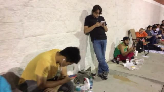 people waiting for midnight release of hottest and newest nintendo console the switch - miami dade county stock videos and b-roll footage