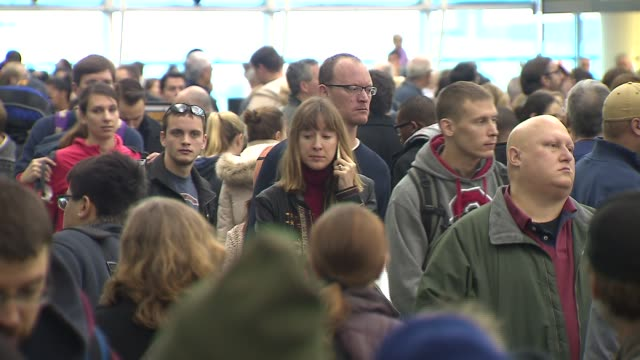 people waiting in line at airport at midway airport on january 03, 2014 in chicago, illinois - crowded airport stock videos & royalty-free footage