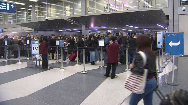 people waiting in line at airport security at chicago o'hare airport on december 13 2013 in chicago illinois - scientific imaging technique stock videos & royalty-free footage