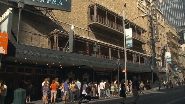 ws people waiting in line at majestic theater on 44th st in manhattan / new york city, usa - broadway manhattan video stock e b–roll