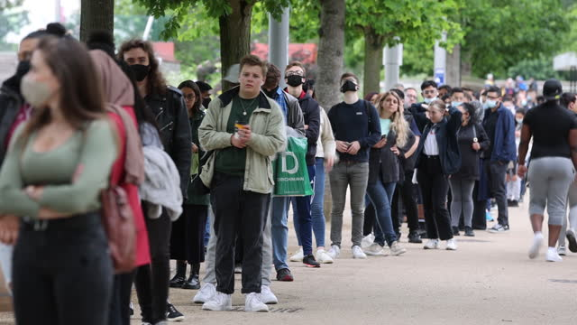 people waiting in line at mass vaccination event at london stadium, in london, u.k. on saturday, june 19, 2021. - new normal concept stock videos & royalty-free footage