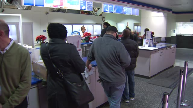 people waiting in line at post office on december 09, 2013 in chicago, illinois - postal worker stock videos & royalty-free footage