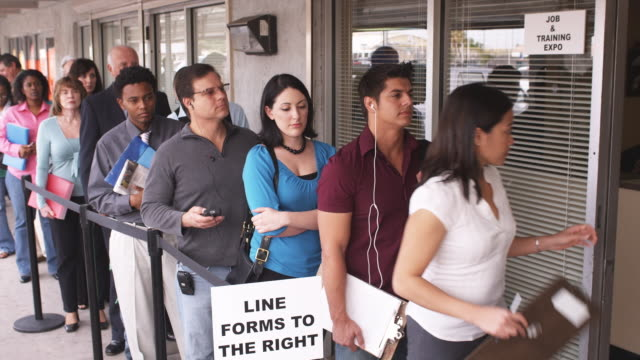 vídeos de stock e filmes b-roll de ms, people waiting in line at unemployment office, phoenix, arizona, usa - tédio