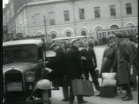 people waiting in line for bus tram passing bg taxi cab cabbie holding bags people in line traffic officer directing arms gesturing women crew rowing... - 1935 stock videos & royalty-free footage