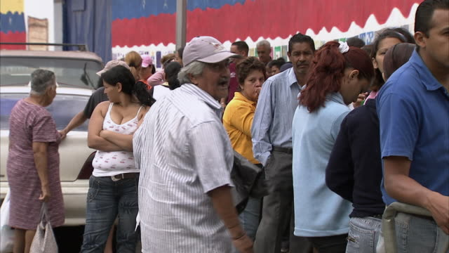 ms zi people waiting in line for food assistance outside mission mercal gates / cabimas, zulia, venezuela - venezuela stock videos & royalty-free footage
