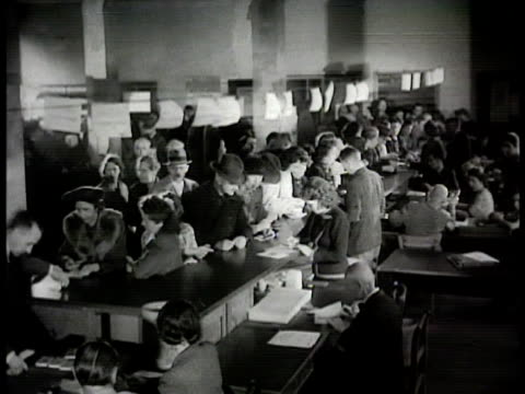 stockvideo's en b-roll-footage met people waiting in line on sidewalk outside german bank int bank w/ people at counter exchanging old currency money for new cu hand stamping paper... - 1948