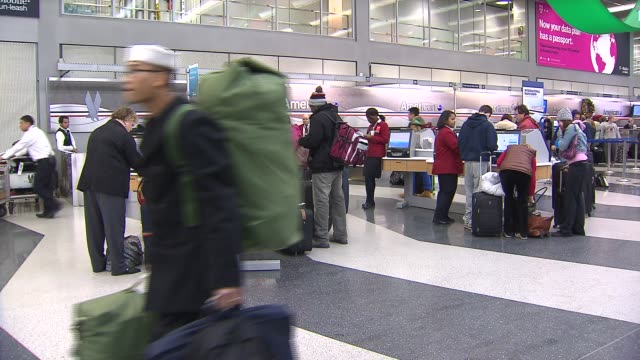 people waiting in line self checkin kiosks at chicago o'hare airport on december 20 2013 in chicago illinois - aeroplane ticket stock videos & royalty-free footage