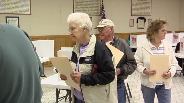 ms, pan, people waiting in line to cast voting ballots into ballot box at polling place, new knoxville, ohio, usa - voting ballot stock videos and b-roll footage