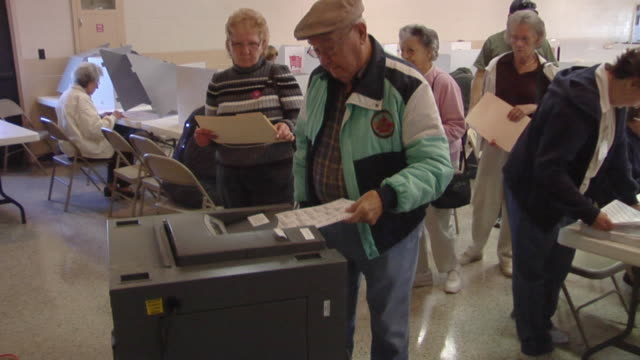 stockvideo's en b-roll-footage met ms, zi, people waiting in line to insert voting ballots into ballot box, st. marys, ohio, usa - stembus