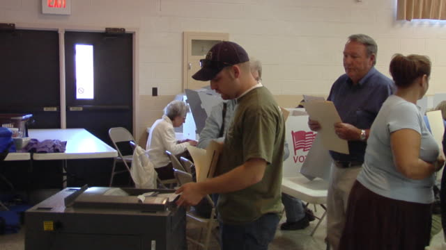 ms, people waiting in line to insert voting ballots into ballot box, st. marys, ohio, usa - voting ballot stock videos and b-roll footage
