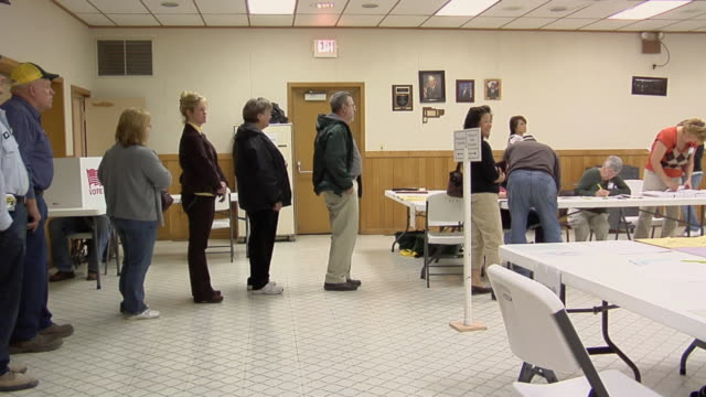 MS, People waiting in line to registration table at polling place, New Knoxville, Ohio, USA