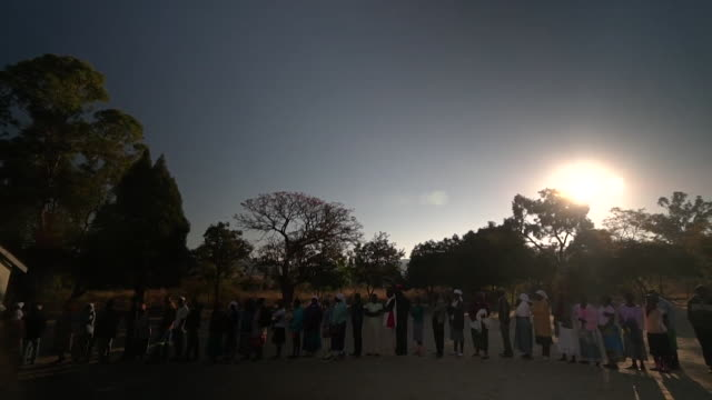 people waiting in line to vote in the zimbabwe presidential election - voting stock videos & royalty-free footage