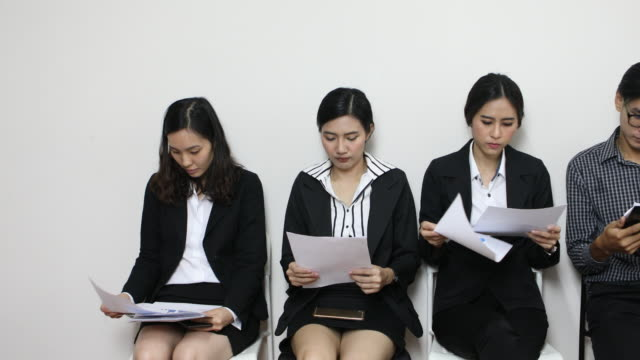 people waiting nervously for job interview - job interview stock videos and b-roll footage