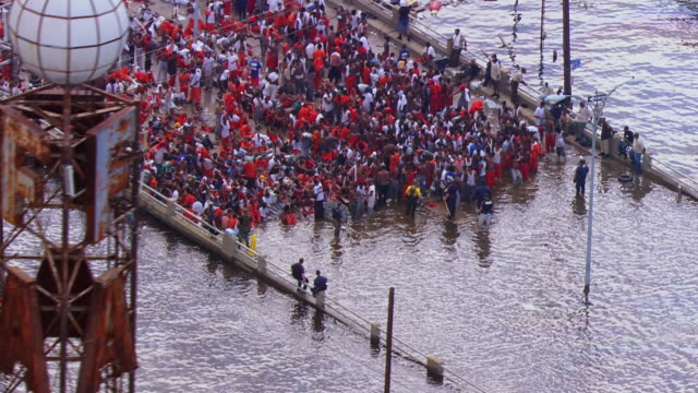 people waiting on bridge for rescue help due to flood / united states - new orleans stock videos & royalty-free footage