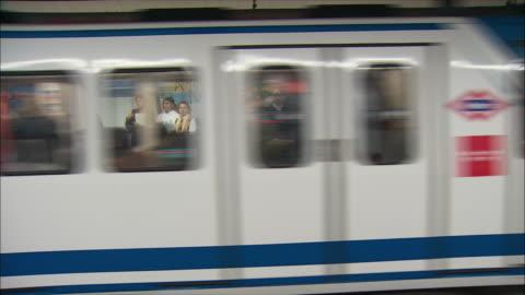 ws people waiting on subway station platform, madrid, spain - underground station platform stock videos & royalty-free footage