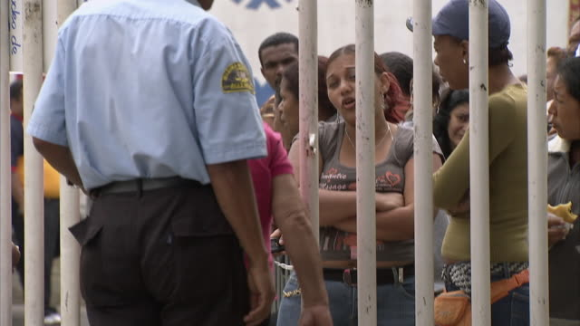 MS TU People waiting outside Mission Mercal gates, security guard letting some people in and out / Cabimas, Zulia, Venezuela