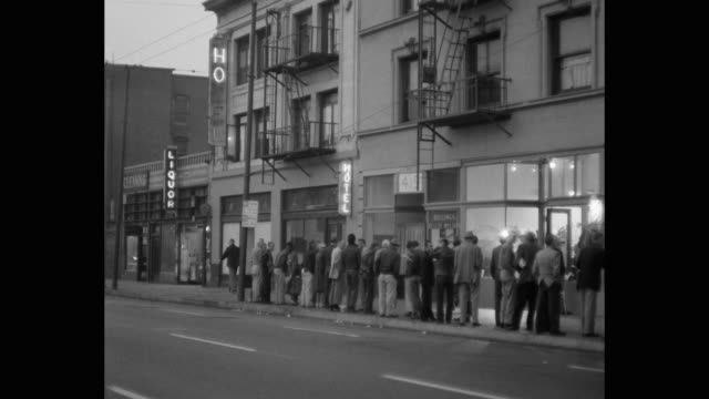 people waiting outside soup kitchen in skid row, los angeles, california, usa - housing difficulties stock videos & royalty-free footage