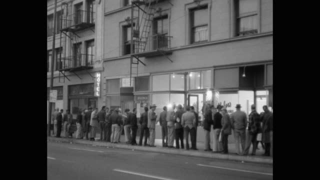 people waiting outside soup kitchen in skid row, los angeles, california, usa - soup kitchen stock videos & royalty-free footage