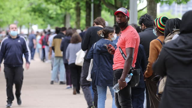 people waiting to get inoculated at mass vaccination event at london stadium, in london, u.k. on saturday, june 19, 2021. - new normal concept stock videos & royalty-free footage