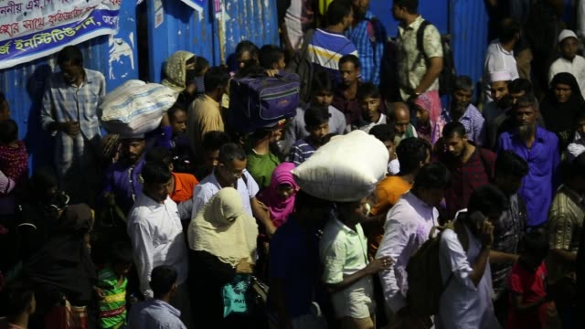 People waits to ride launch to go to Dhaka the capital city of Bangladesh Bangladesh a country which is ranked as one of the world's most vulnerable...