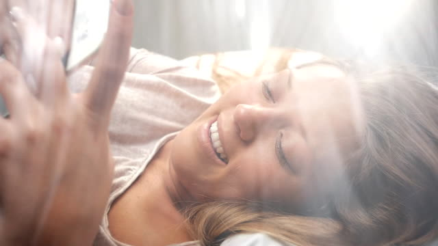 People Waking Up Young Woman Texting In Bed Stock Footage