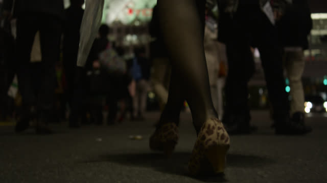 people walk across shibuya crossing in tokyo. - human leg stock videos & royalty-free footage