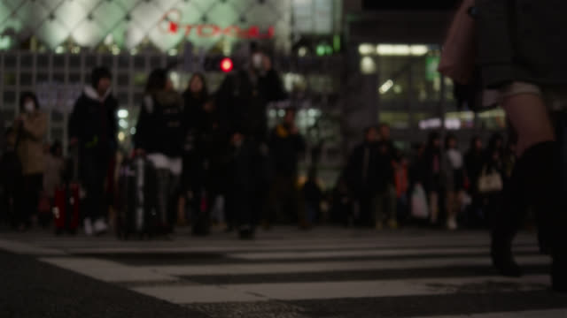 people walk across shibuya crossing in tokyo. - crossing stock videos & royalty-free footage