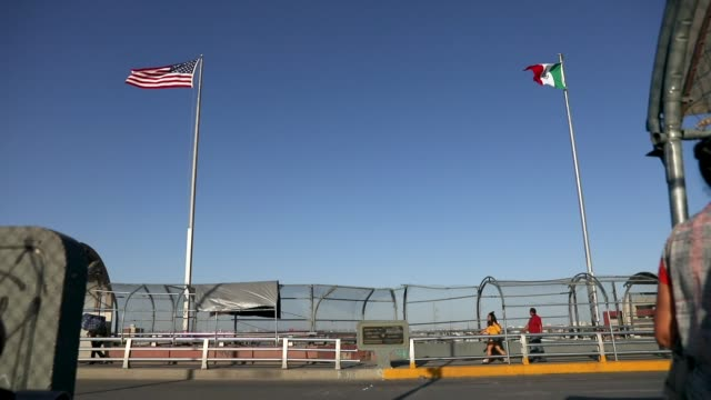 People walk across the Paso Del Norte Port of Entry bridge which connects the US and Mexico on July 23 2018 in El Paso Texas A courtordered July 26th...