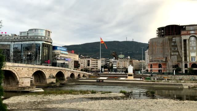 people walk across the stone bridge near macedonia square on september 28 2018 in skopje macedonia macedonians will go to the polls sunday to vote in... - macedonia country stock videos and b-roll footage