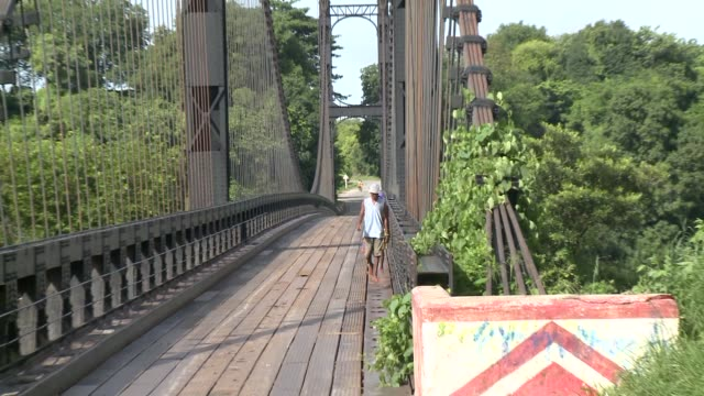 people walk along a bridge in madagascar. available in hd. - footbridge stock videos & royalty-free footage