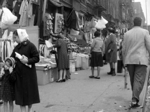people walk along a street in the harlem area of new york - harlem stock videos & royalty-free footage