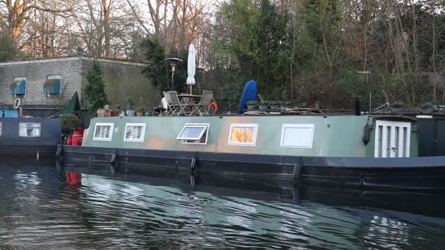 people walk along regents canal by regent's park during the third national lockdown, of the covid-19 pandemic on january 09, 2021 in london, england.... - barge stock videos & royalty-free footage