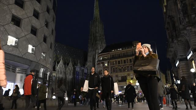 people walk along stephansplatz and the popular graben pedestrian shopping zone the day before a strict nationwide lockdown is to go into effect on... - austria stock videos & royalty-free footage