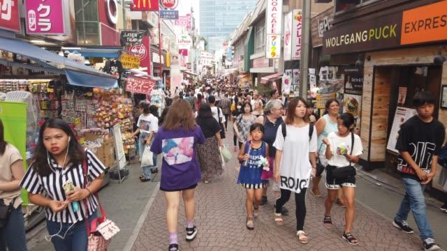 people walk along takeshita street in harajuku tokyo on august 07 2019 in tokyo japan - lifestyles stock videos & royalty-free footage