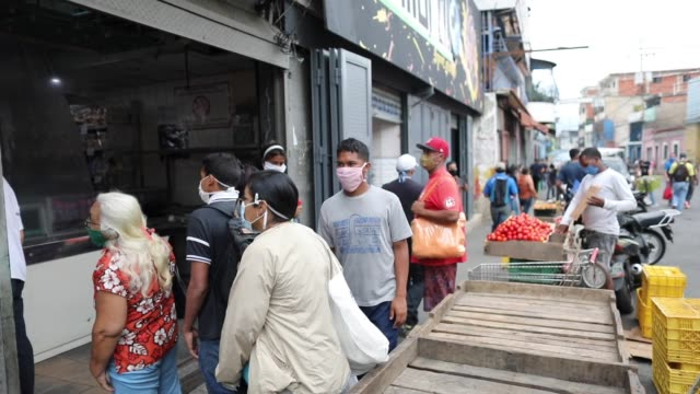 people walk along the boulevard of the lower la vega in search of food venezuelans take to the streets to look for food regardless of social... - boulevard stock videos & royalty-free footage