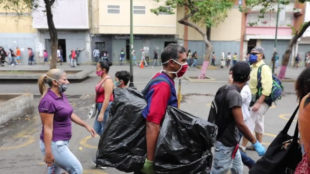people walk along the boulevard of the slum catia following the security laces put by members of the national guard venezuelans take to the streets... - boulevard stock videos & royalty-free footage