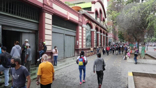 people walk along the boulevard of the slum catia in front of the popular market venezuelans take to the streets to look for food regardless of... - boulevard stock videos & royalty-free footage