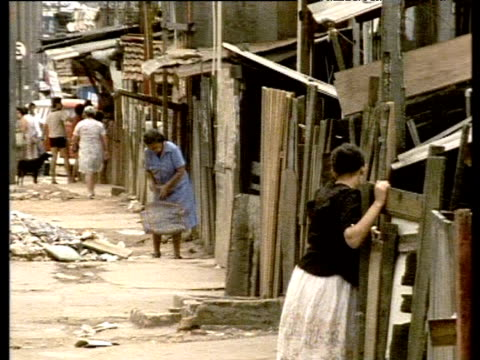 people walk and children play in alleys of favela - south america stock videos & royalty-free footage